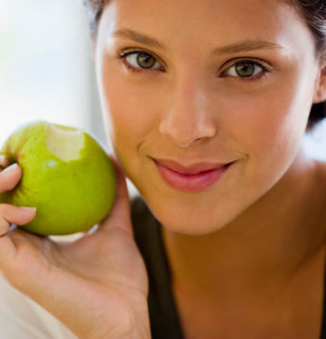 Lady holding a green apple , Nutritional foods